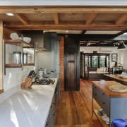 The generous use of wood in the design architecture, beam, building, ceiling, countertop, design, dining room, estate, floor, flooring, furniture, hardwood, home, house, interior design, kitchen, living room, loft, plywood, property, real estate, room, table, wood, wood flooring, wood stain, brown, gray