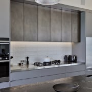The colour/material palette of taupe grey and bronzed architecture, countertop, cuisine classique, interior design, kitchen, light fixture, under cabinet lighting, gray