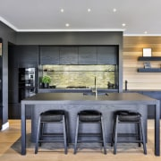 Even the fridge and stool tops are black