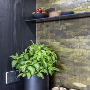 Textured mosaic tiles help to create a warm