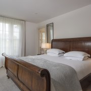 The master bedroom includes a beautiful sleigh bed.