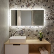 Cantilevering the vanity adds to the bathroom's sense