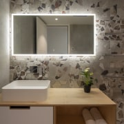 Mirror backlighting provides quality task lighting and includes