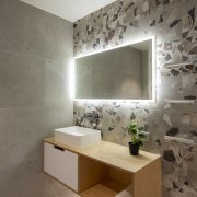 Wall mounted tapware and a slender tabletop basin