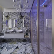 The sumptuous master bathroom includes a bespoke wardrobe