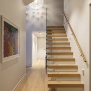 Stairs lead up the first floor master suite
