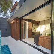 The poolhouse is all but self sufficient, with