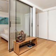 The use of sliding glass panels maintains the