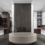 This hone's drama extends to the master bathroom,