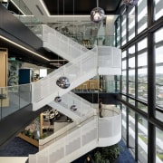 The dramatic ANZ Raranga base building stair is black, gray