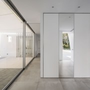 Sliding doors give the home a modularity - architecture, ceiling, daylighting, door, floor, flooring, glass, house, interior design, real estate, gray