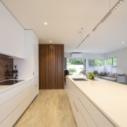 The absence of protruding cabinetry handles contributes to
