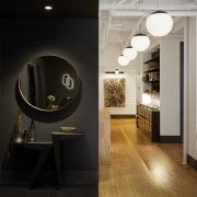 Refined design touches and lustrous wood flooring contrast