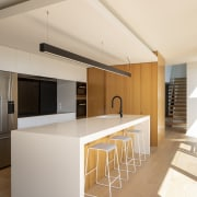 A dropped ceiling delineates the heart-of-the-home wood and