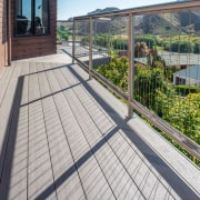 A Superb Deck Finish Is Achieved With TimberTechs architecture, balcony, deck, handrail, outdoor structure, property, real estate, roof, walkway, gray