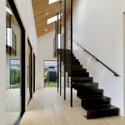 A fabulous steel staircase is one early-seen feature gray