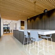 The heart-of-the-home kitchen includes a cantilevered breakfast bar. gray