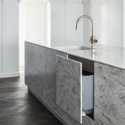 This kitchen's exotic reversed Corian Witch Hazel surface