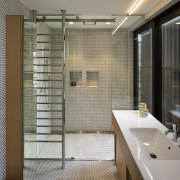 Glass, chrome and mosaics make for a clean,