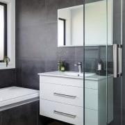 The main bathroom includes an Athena Liquid tub,