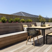 The generous deck includes built-in seating – this