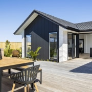 The sprawling rear deck includes sheltered, private outdoor