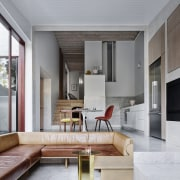A fireplace sits adjacent a sunken dining and