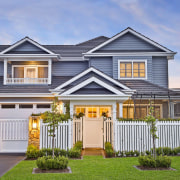 An elegant, traditional facade greets guests to this architecture, building, cottage, estate, facade, fence, home, home fencing, house, neighbourhood, picket fence, property, real estate, residential area, roof, siding, suburb, gray