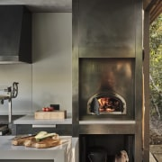 A substantial stainless steel oven is a hard-working