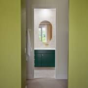 A vista into the reinvented bathroom from the