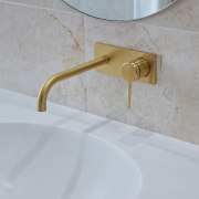 Brushed brass fittings add to the simple, yet