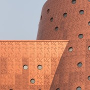 Round skylights in the museum facade admit natural architecture, brick, wall, orange, gray