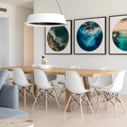 Selected artworks provide splashes of colour within the building, ceiling, chair, design, dining room, floor, furniture, home, house, interior design, living room, property, room, table, turquoise, white