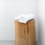 The unusual shower seat introduces a natural touch