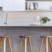 Timber stools work well with the kitchen's other