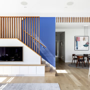 A bold blue wall in the stairwell adds
