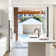 The kitchen flows seamlessly out to the outdoor