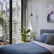The main bedroom opens onto a balcony with