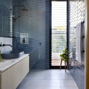 The sun-drenched bathroom takes full advantage of its