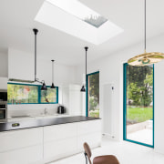 Bathed in natural light from the skylight, the