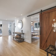 Inside this home's generous planked front doors, a