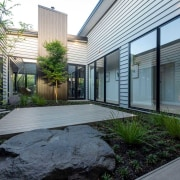 Together, the courtyard's artfully composed natural elements evoke