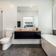 The master ensuite includes character tiling, a freestanding