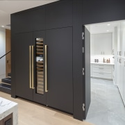 This cabinetry wall includes a concealed door to