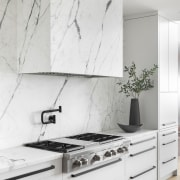 Italian marble covers the backsplash wall. - Touching