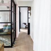 Lim+Lu's apartment transformation creates a flexible living environment floor, flooring, interior design, laminate flooring, room, wood, wood flooring, white, gray