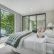 The main bedroom suite is also located in