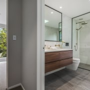 Creating a wet room with glass shower divider