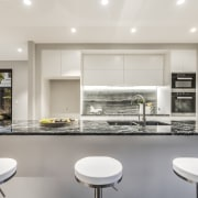 The striking material used for the kitchen island