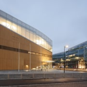The artistic Helsinki library is a giant magnet architecture, building, city, commercial building, corporate headquarters, facade, headquarters, metropolitan area, mixed-use, sky, teal